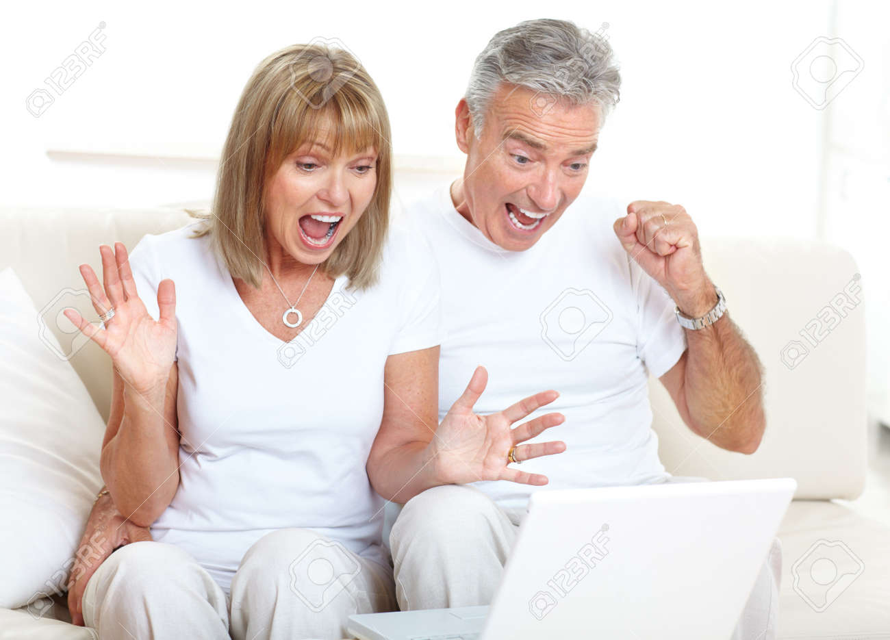 Senior couple  working with laptop at home Stock Photo - 7415103
