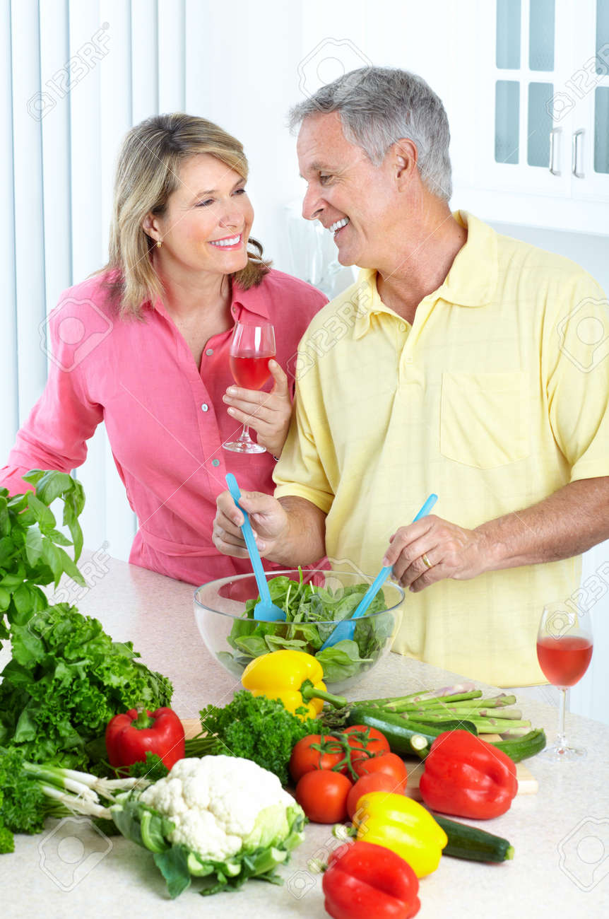 Happy seniors couple cooking at kitchen Stock Photo - 7415258
