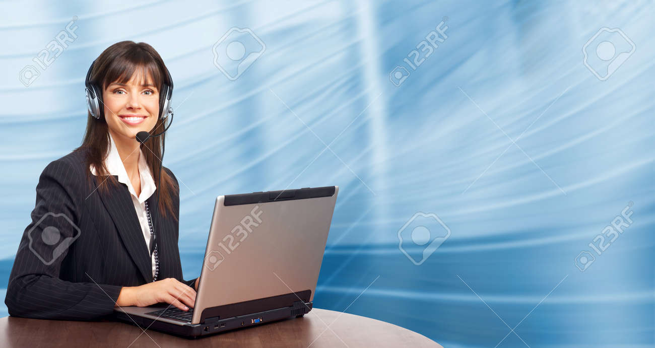 Beautiful  business woman with headset. Over blue background Stock Photo - 7447115