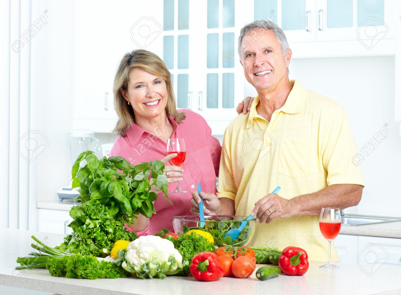 Happy seniors couple cooking at kitchen Stock Photo - 7465750