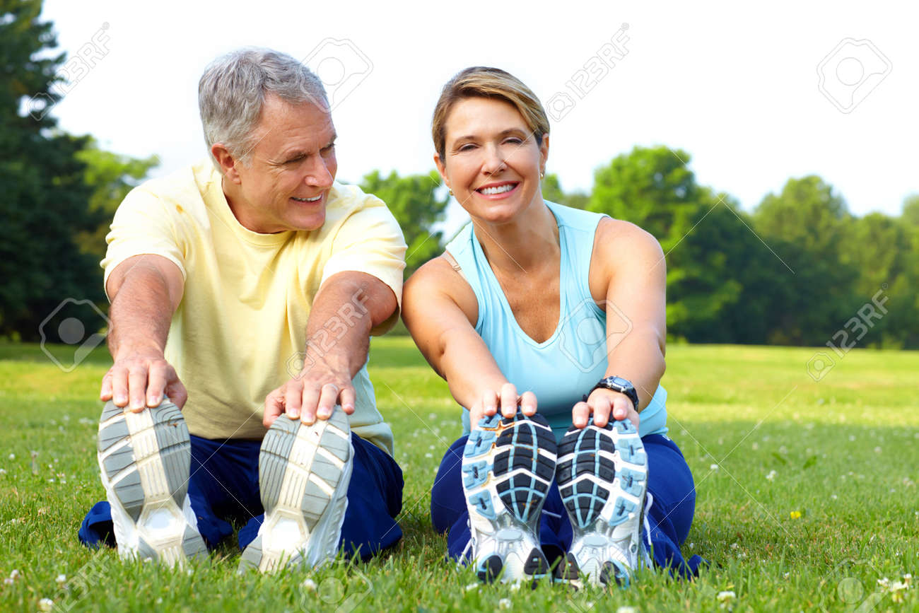 Happy elderly seniors couple working out in park Stock Photo - 7513411