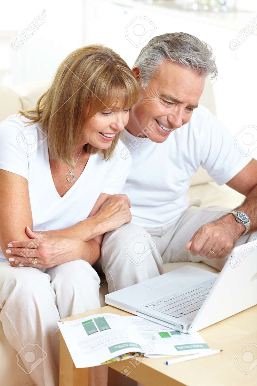 Senior couple  working with laptop at home Stock Photo - 7552693