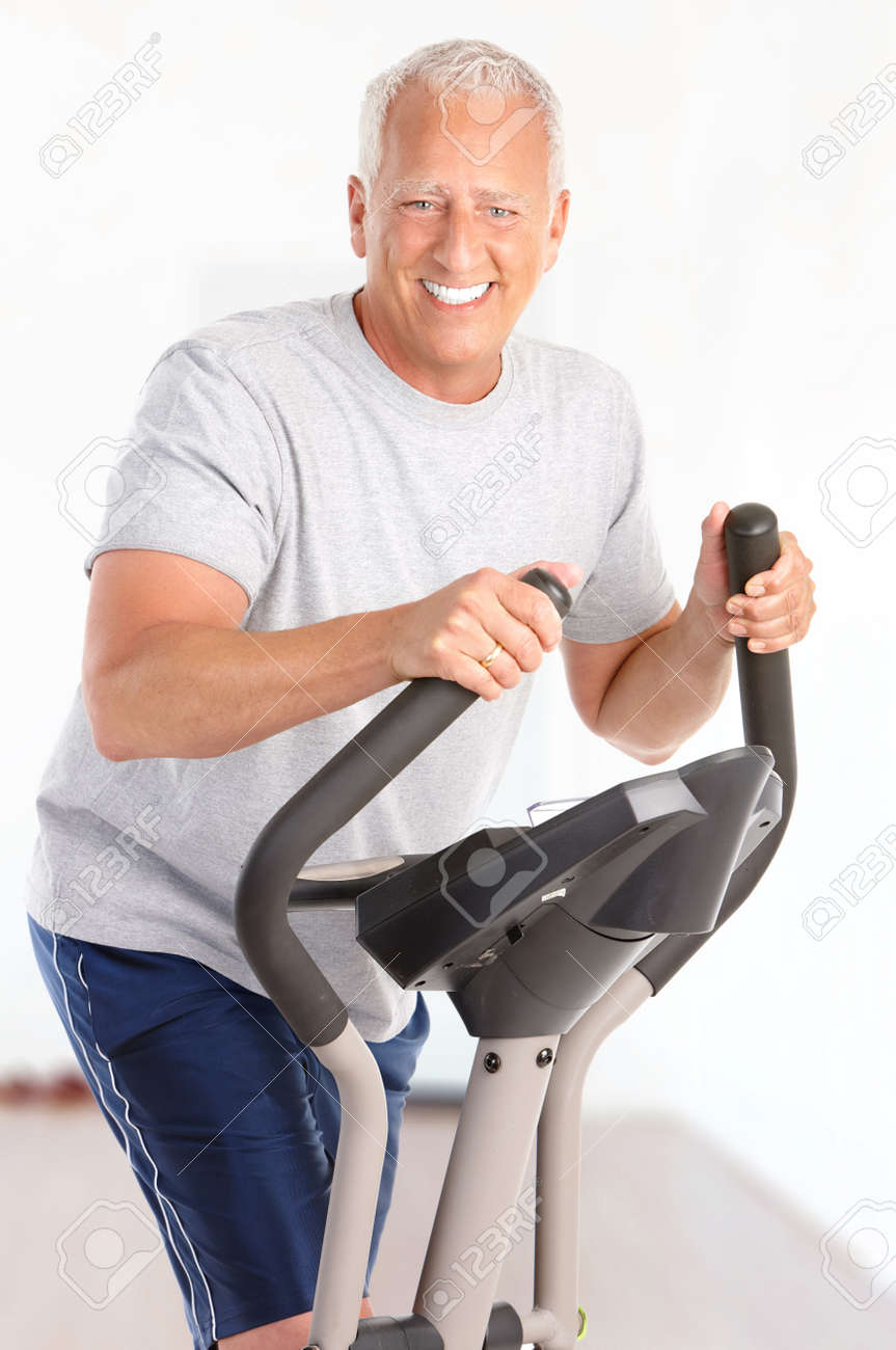 Gym fitness smiling elderly man working out at home stock photo