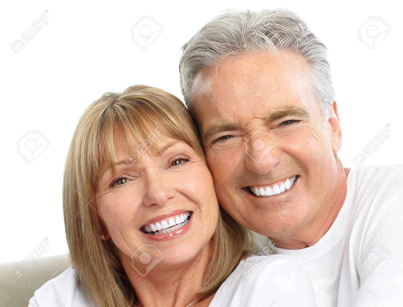 Happy seniors couple in love. Healthy teeth. Isolated over white background Stock Photo - 7607096