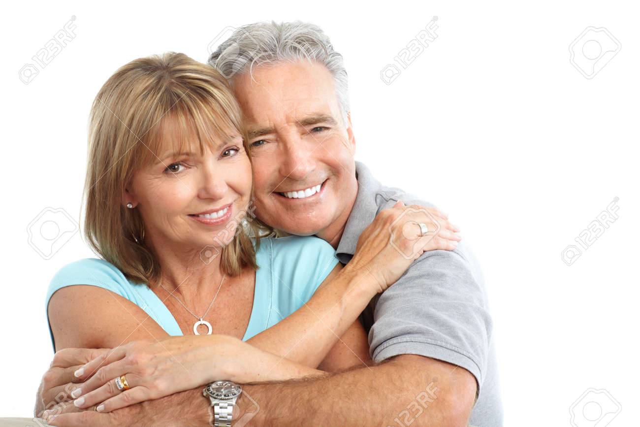 Happy seniors couple in love. Healthy teeth. Isolated over white background - 7635089