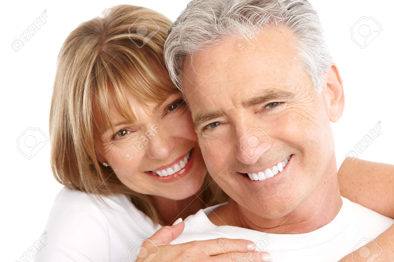Happy seniors couple in love. Healthy teeth. Isolated over white background Stock Photo - 7635189