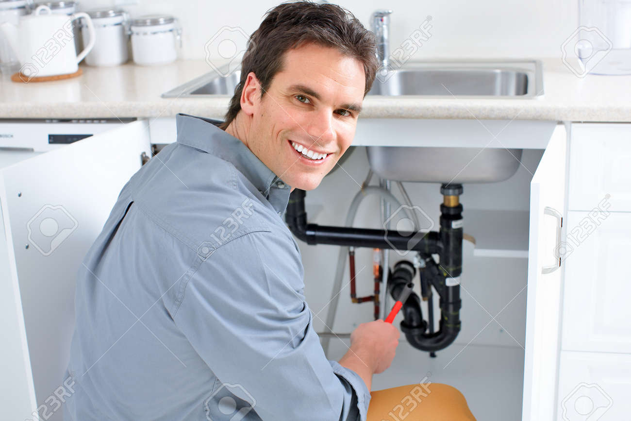 Young Plumber Fixing A Sink Stock Photo, Picture And Royalty Free ...