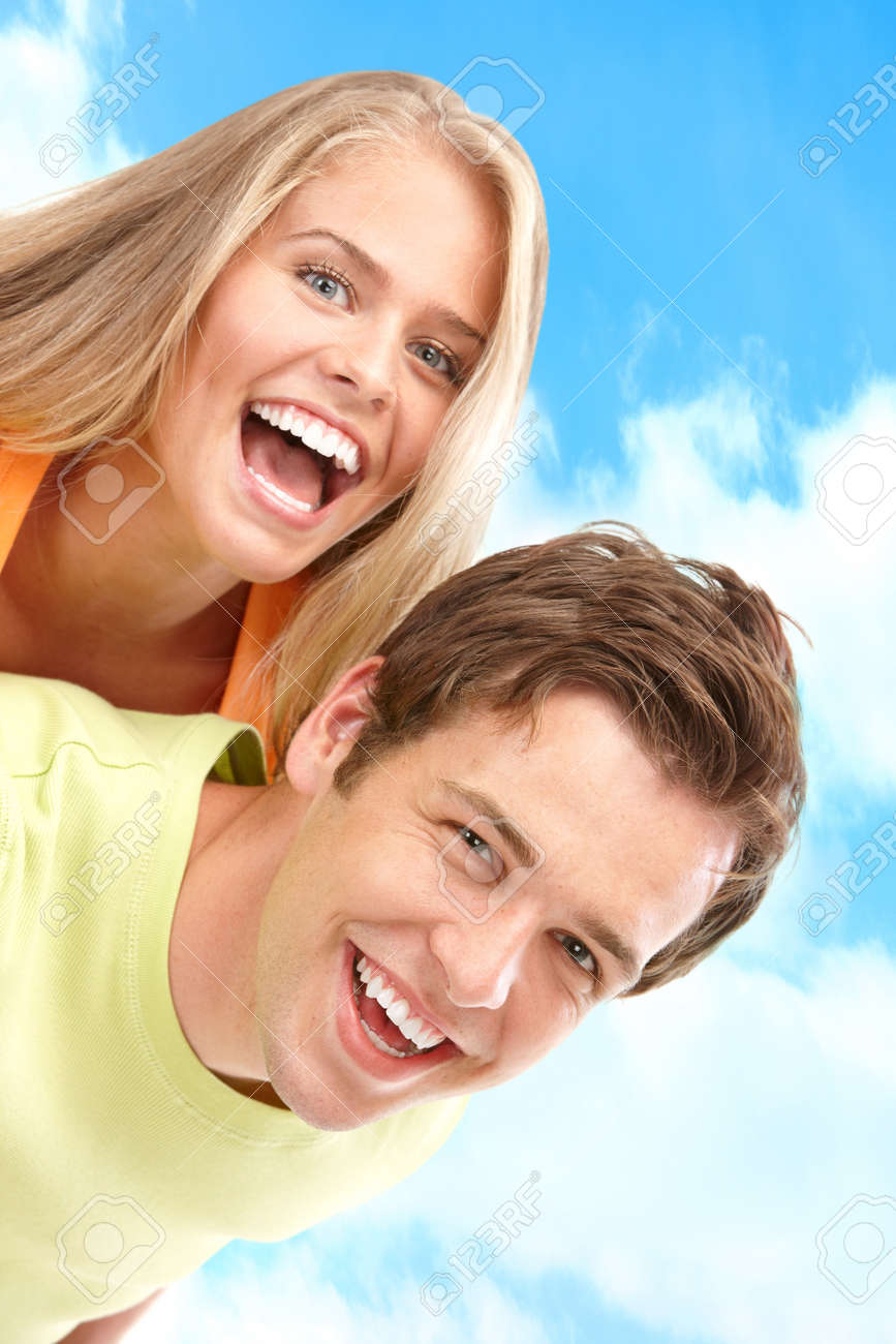 Young love couple smiling under blue sky Stock Photo - 7703046