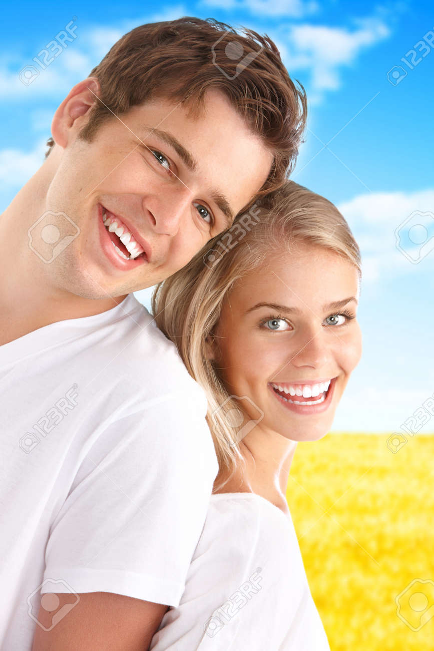 Young love couple smiling under blue sky Stock Photo - 7703027