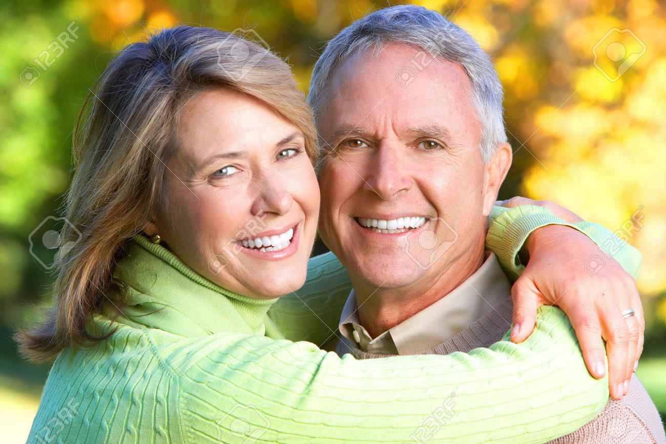 Happy elderly seniors couple in park Stock Photo - 7726400