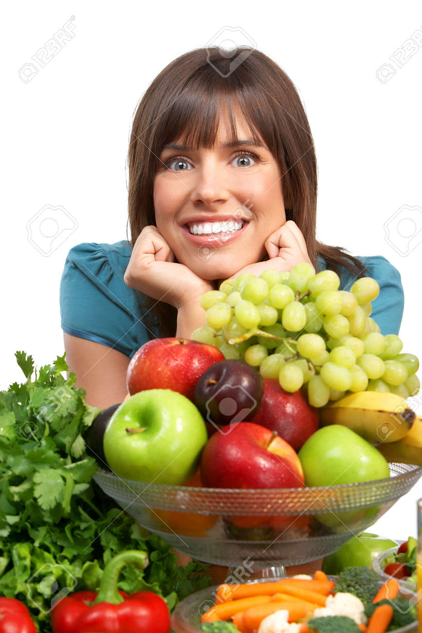 Young smiling woman  with fruits and vegetables. Over white background Stock Photo - 7872675