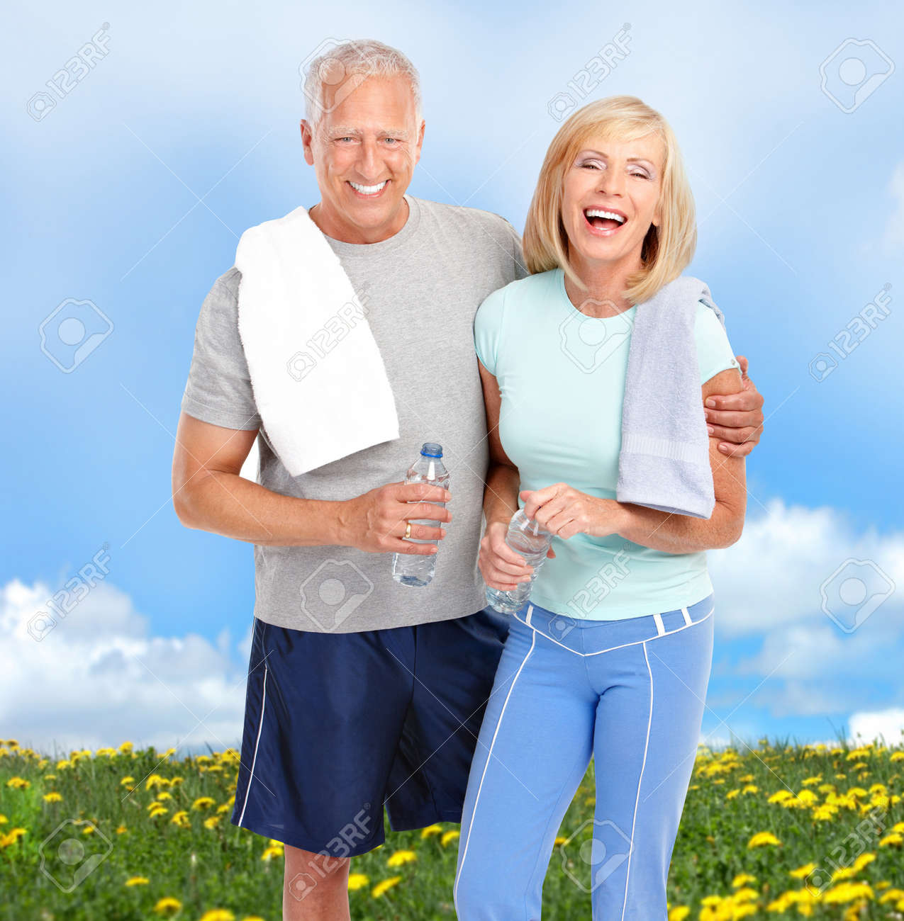 Happy elderly senior couple relaxing in the park Stock Photo - 8074344