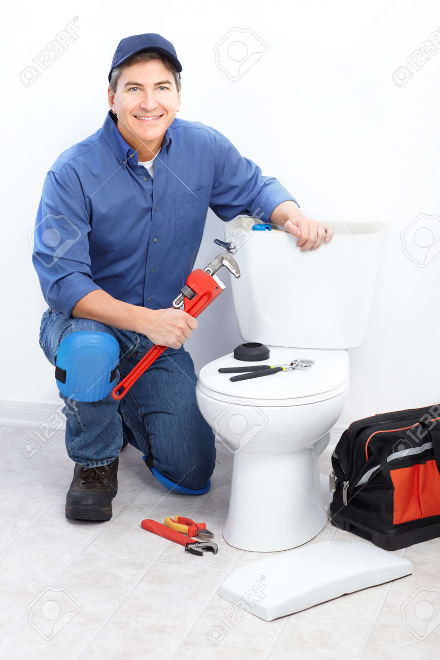 Mature Plumber Near A Flush Toilet Stock Photo, Picture And Royalty ...