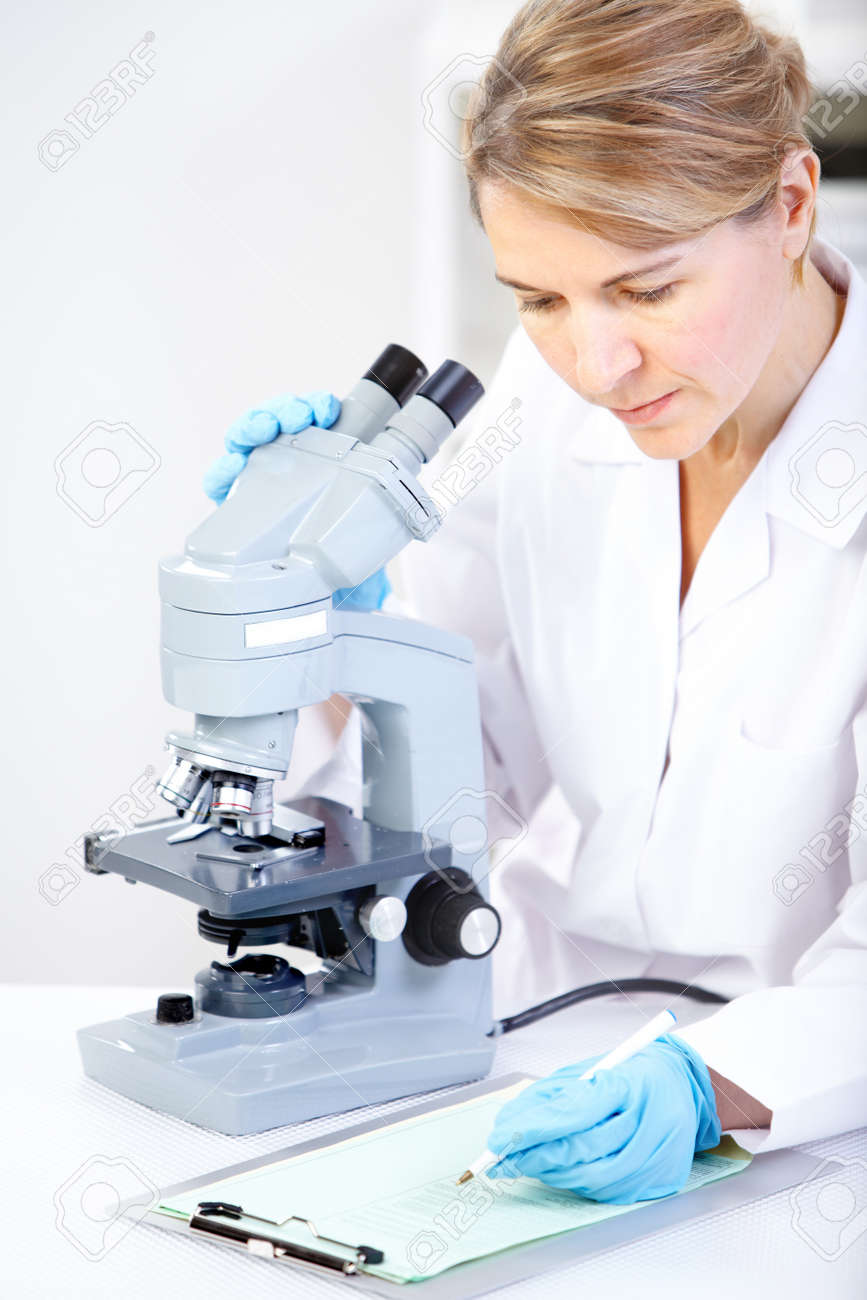 Woman Working With A Microscope In A Lab Stock Photo, Picture And ...