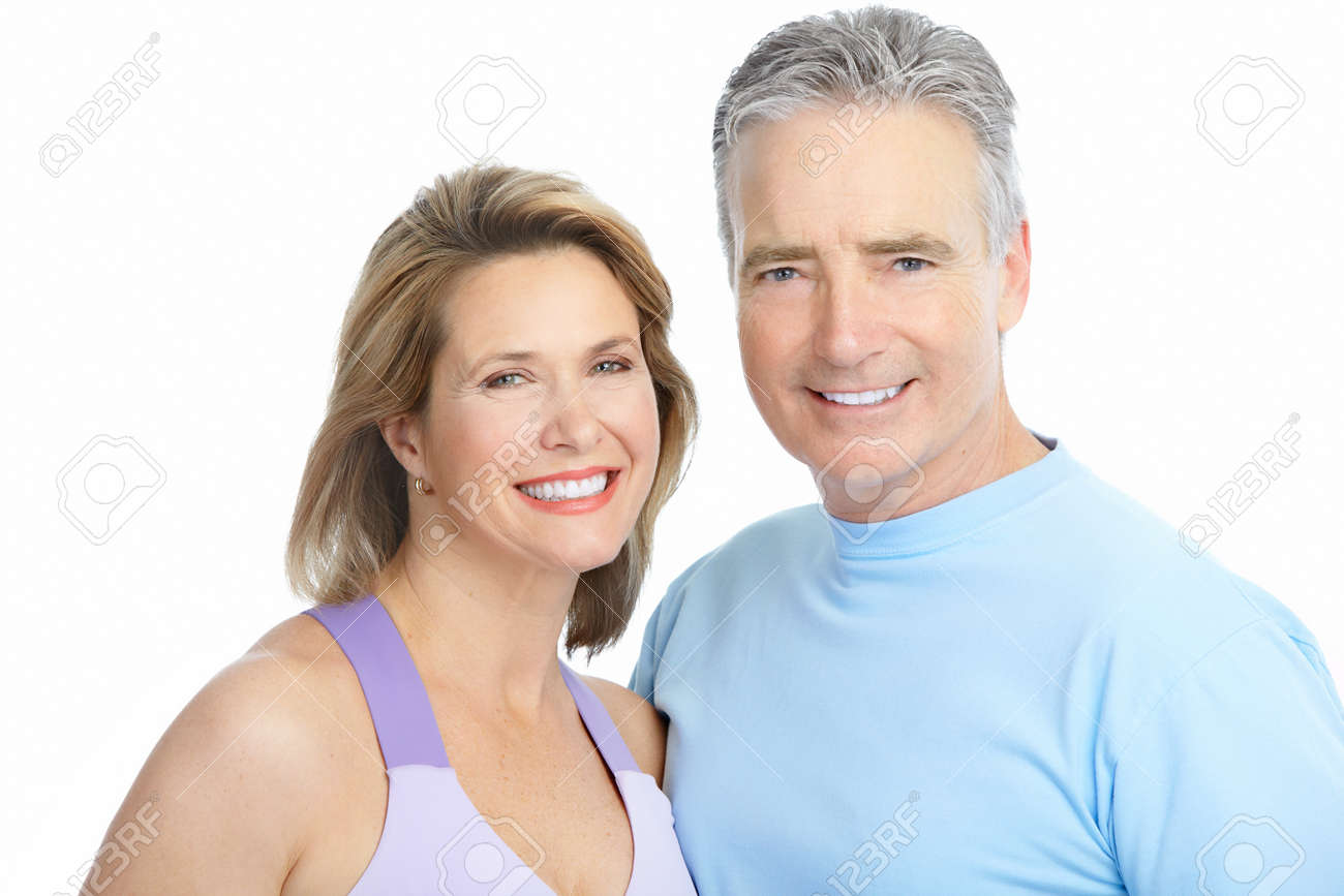 Happy seniors couple in love. Healthy teeth. Isolated over white background Stock Photo - 8554982
