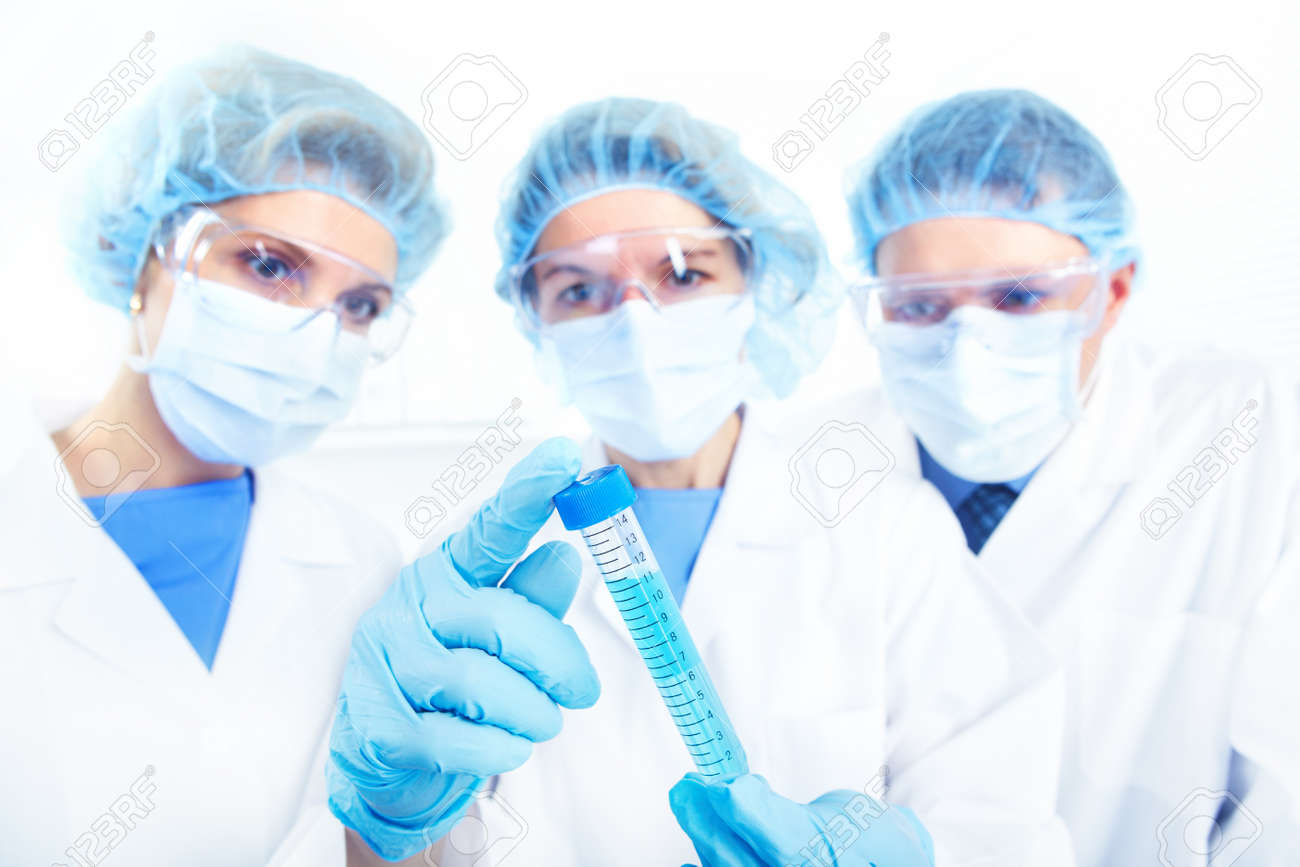 Science team working with test tubes at  laboratory Stock Photo - 8554839