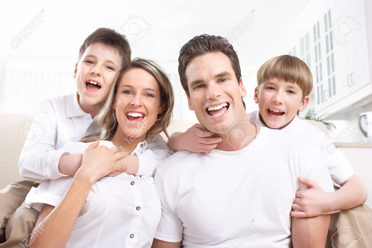 Happy family. Father, mother and children at home Stock Photo - 8554855