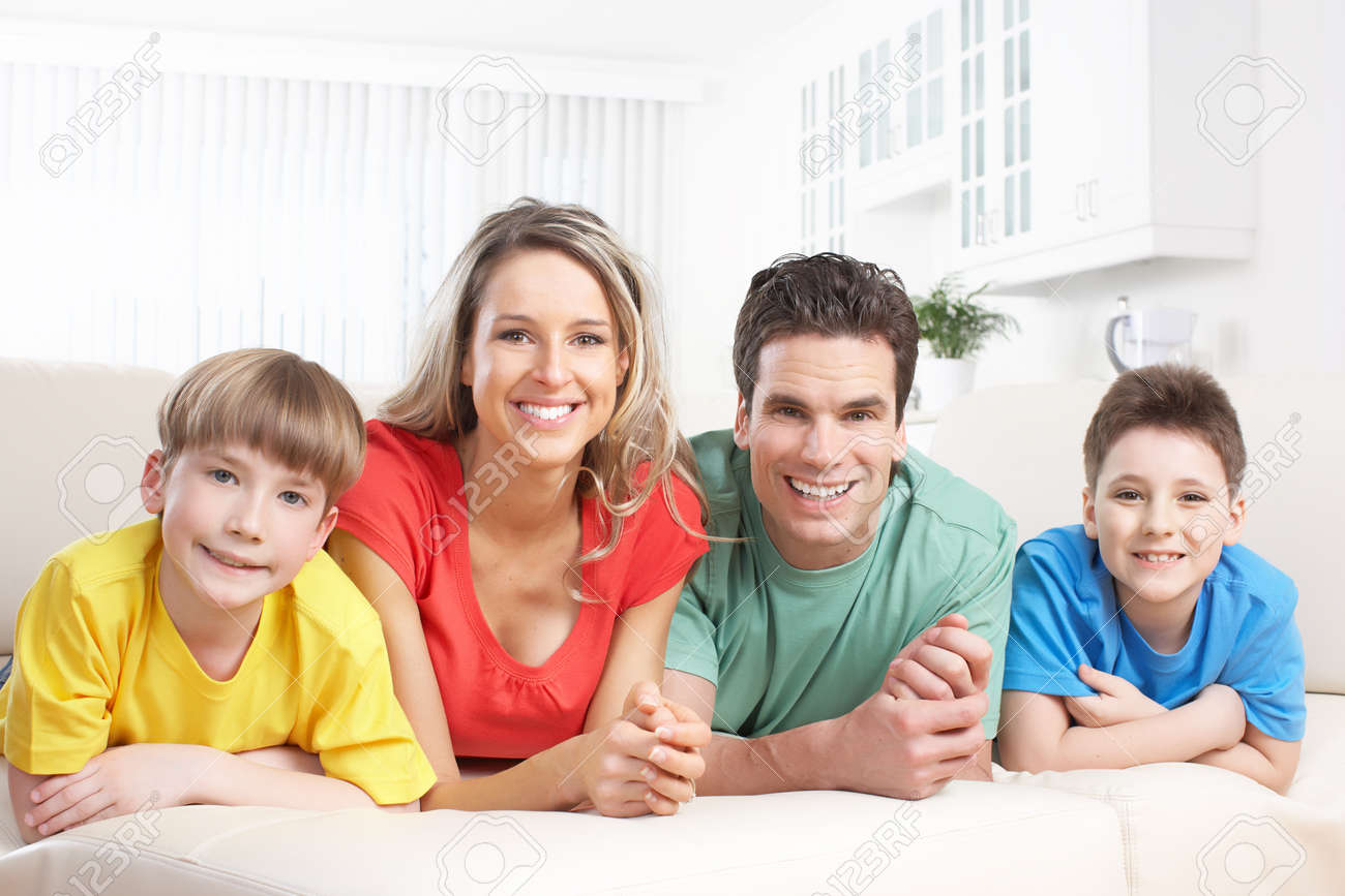 Happy family. Father, mother and children at home Stock Photo - 8554869