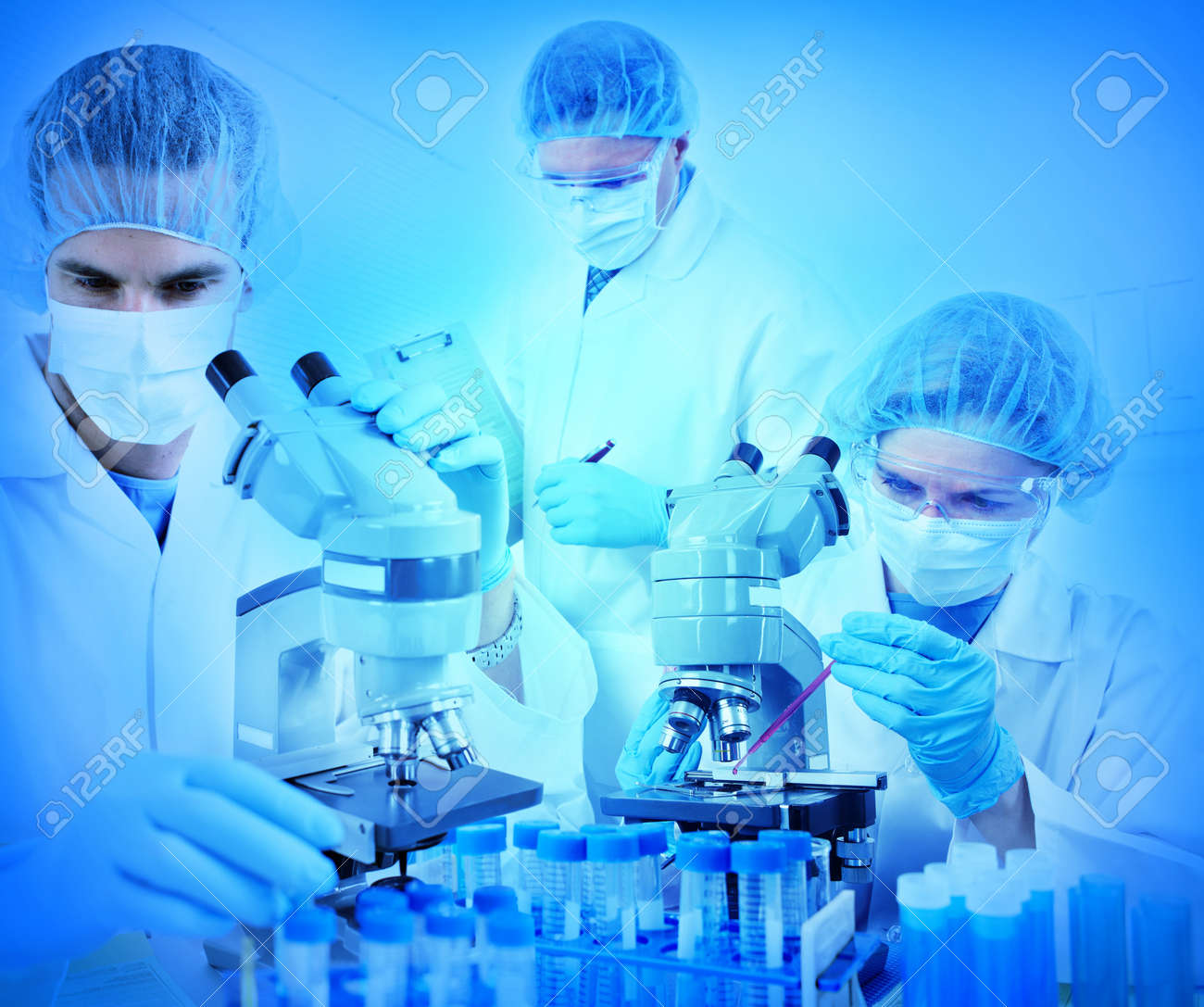 Science team working with microscopes at  laboratory Stock Photo - 8591835