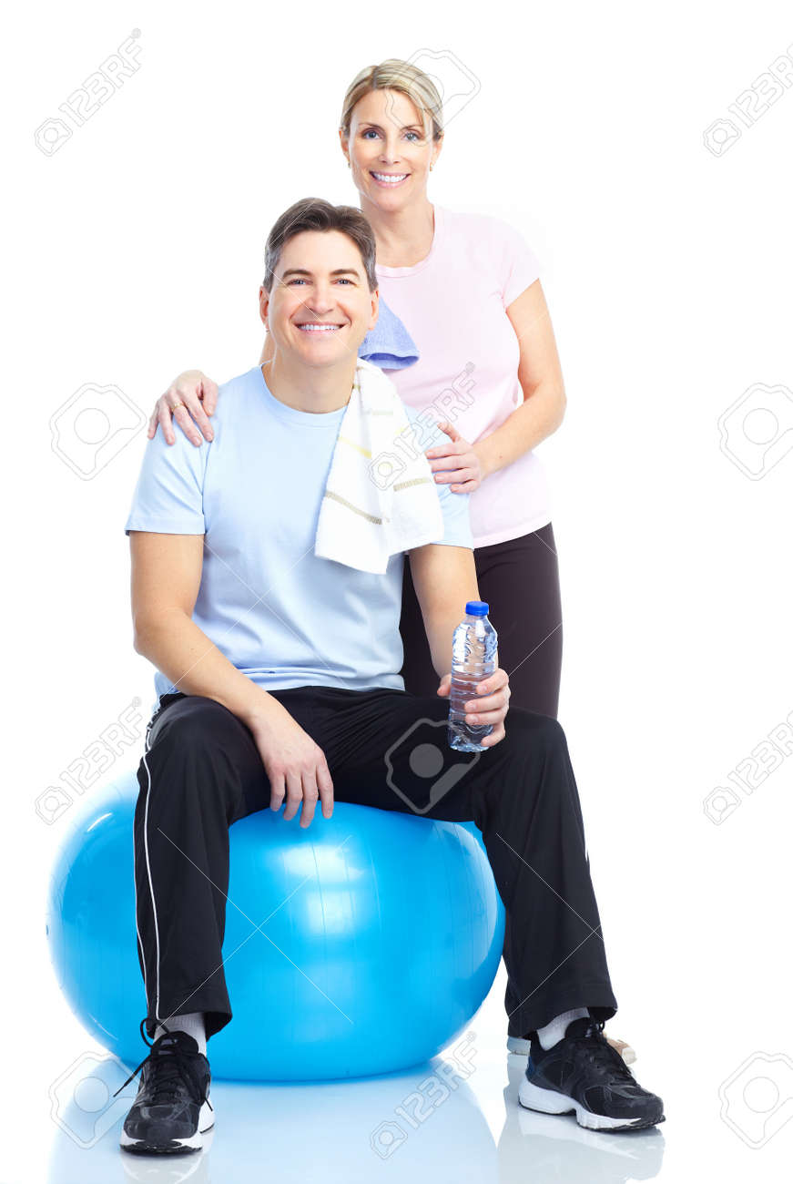 Gym & Fitness. Smiling mature couple working out. Isolated over white background Stock Photo - 8736432