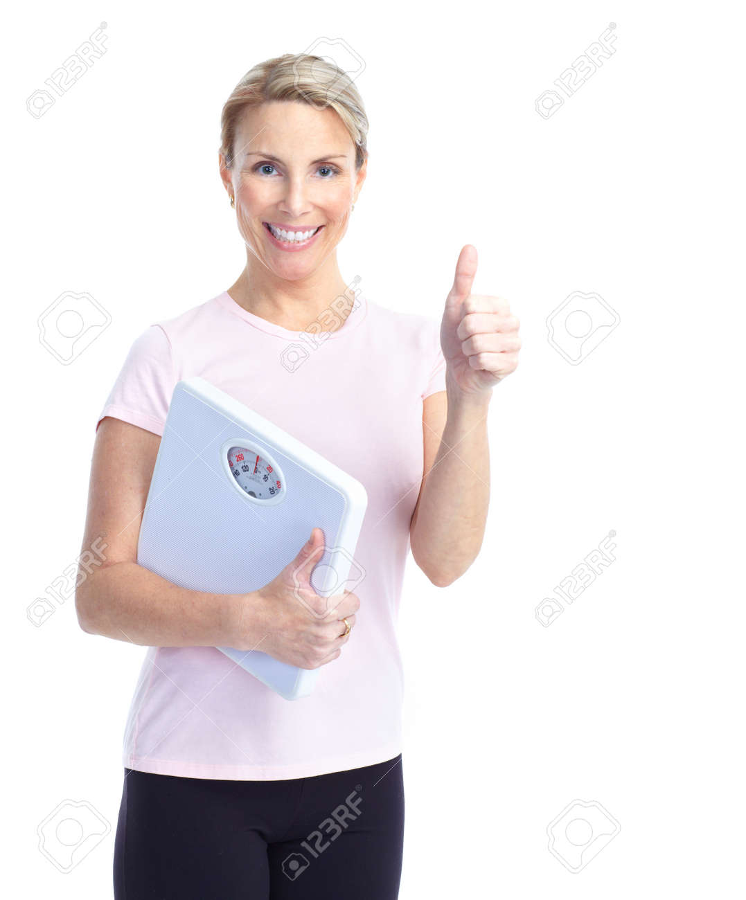 Gym & Fitness. Smiling mature woman with a bathroom scale Stock Photo - 8738149
