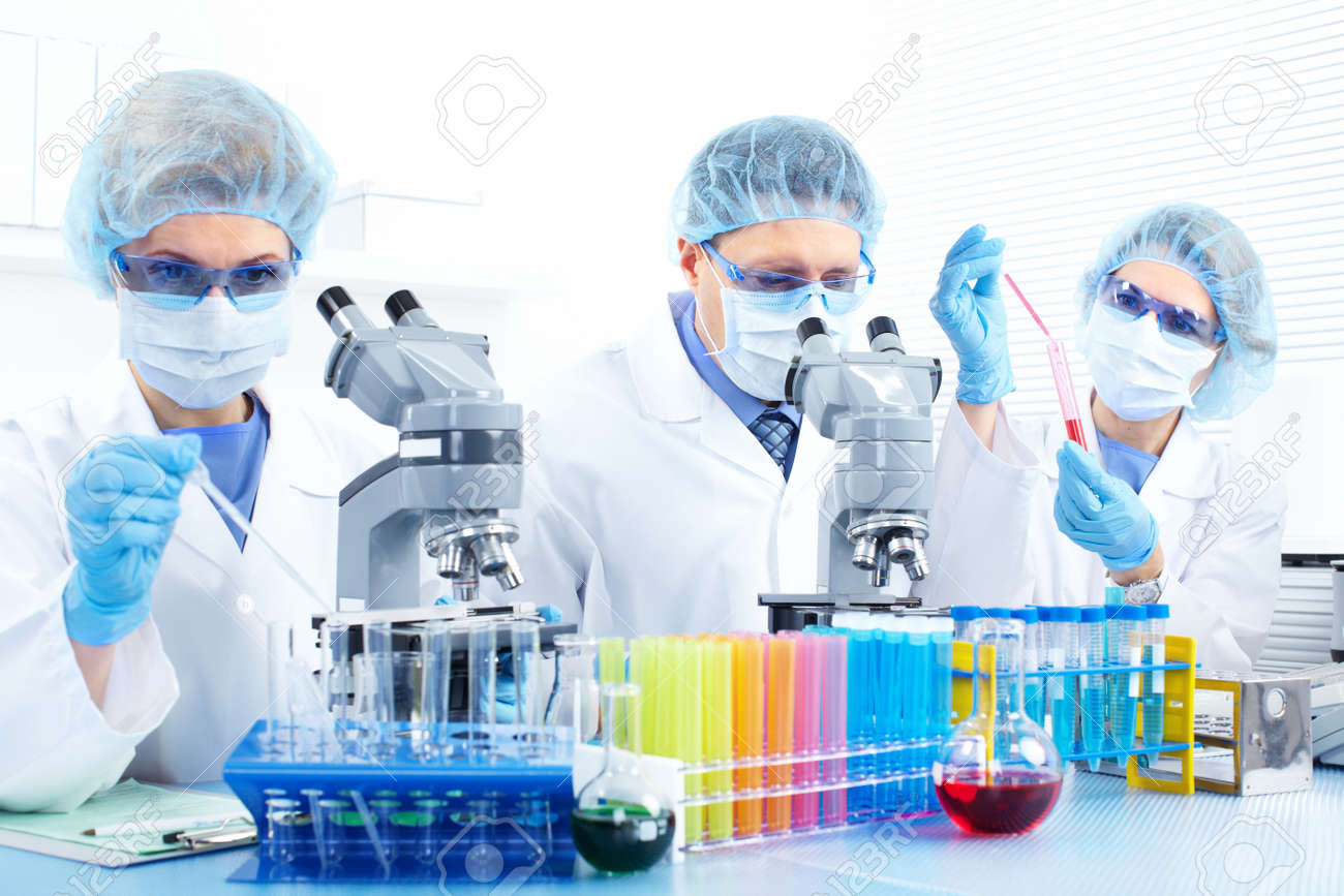 Science team working with microscopes at  laboratory Stock Photo - 8738277