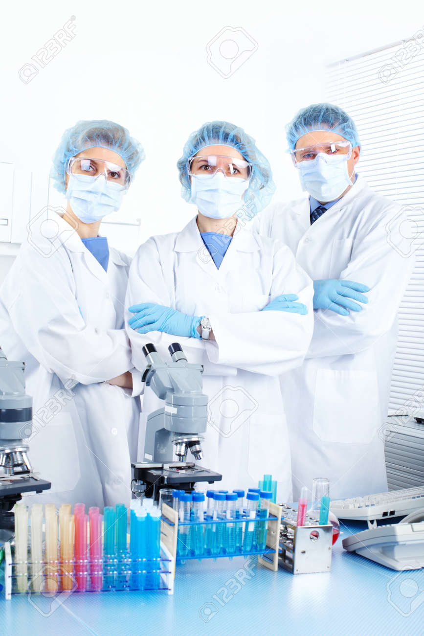 Science team working with microscopes at  laboratory Stock Photo - 8738234