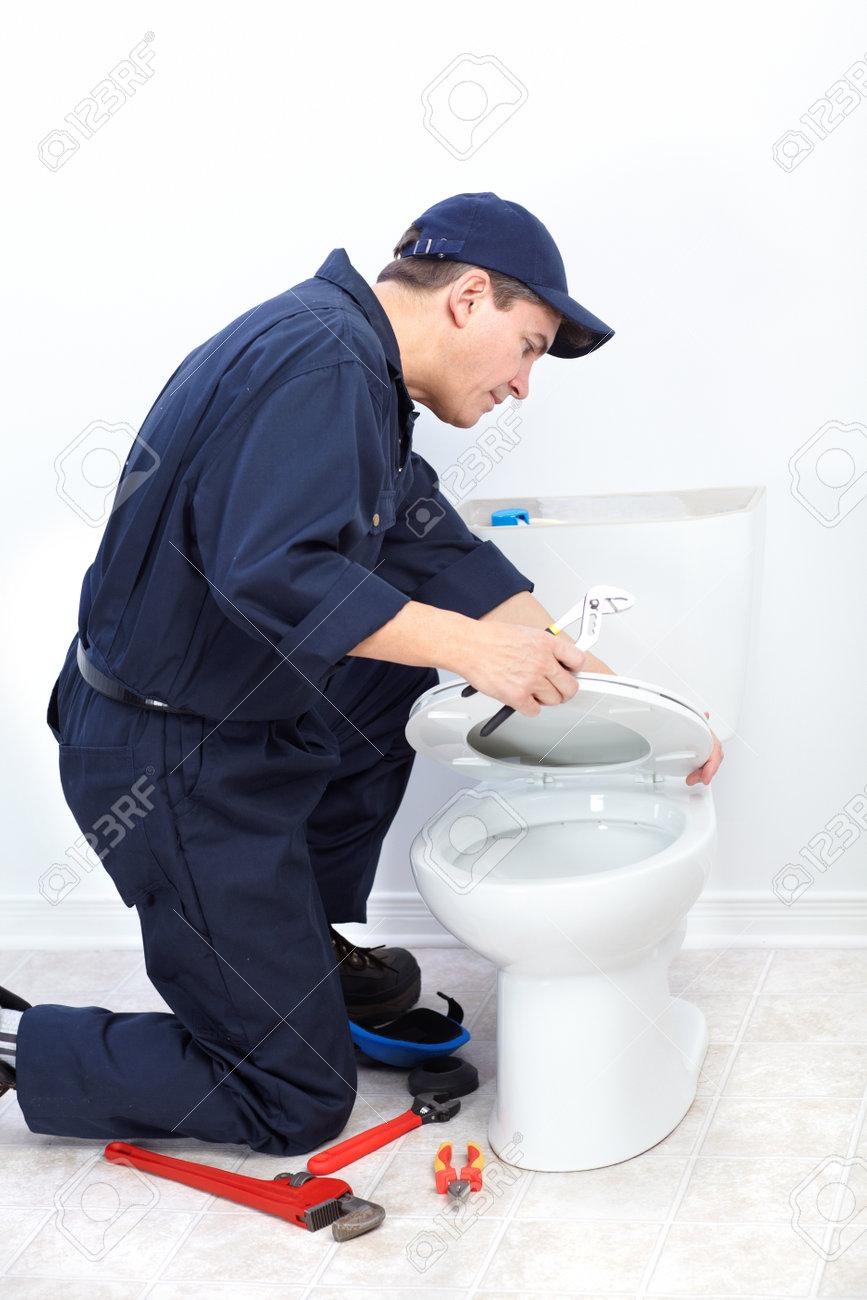 Mature plumber near a flush toilet Stock Photo - 8856872