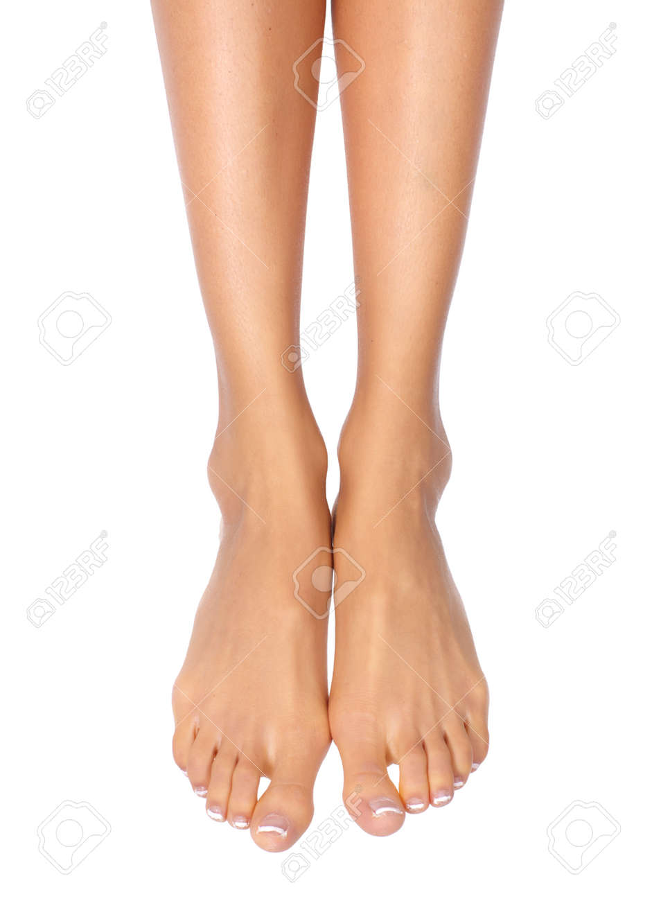 Female Feet. Isolated Over White Background Stock Photo, Picture And ...