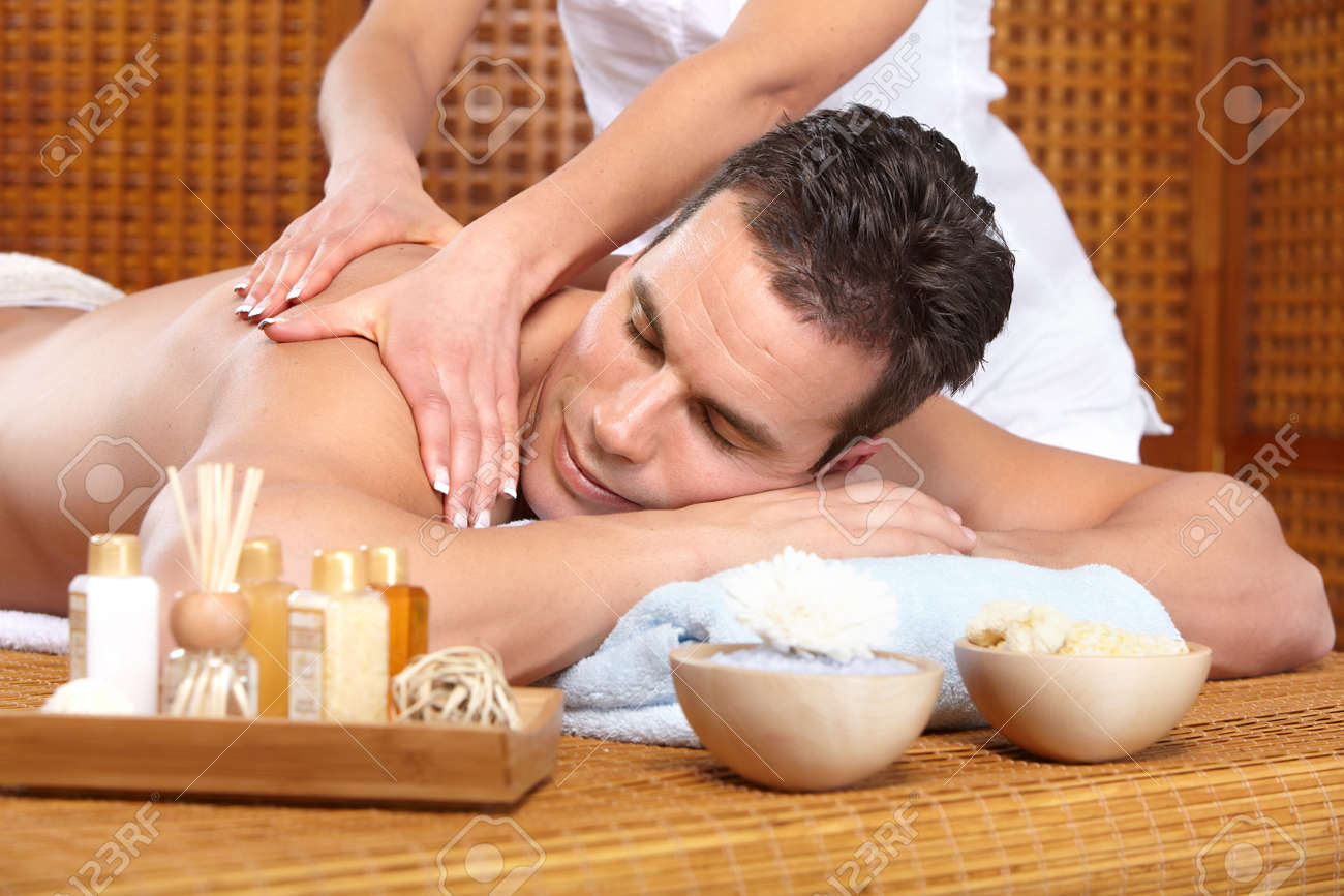 young handsome man getting a massage Stock Photo - 8863788