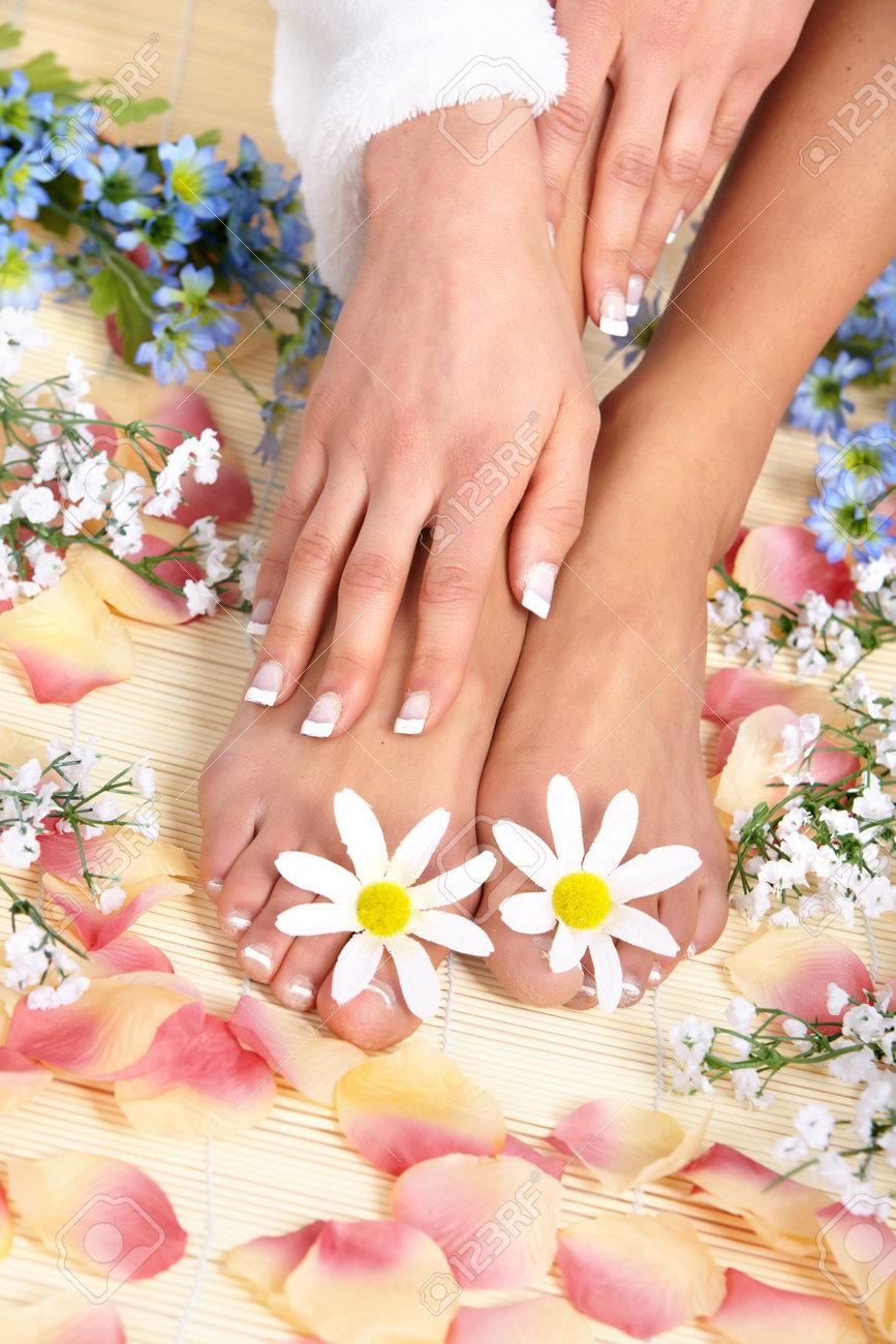 Female feet massage and flowers Stock Photo - 8863816