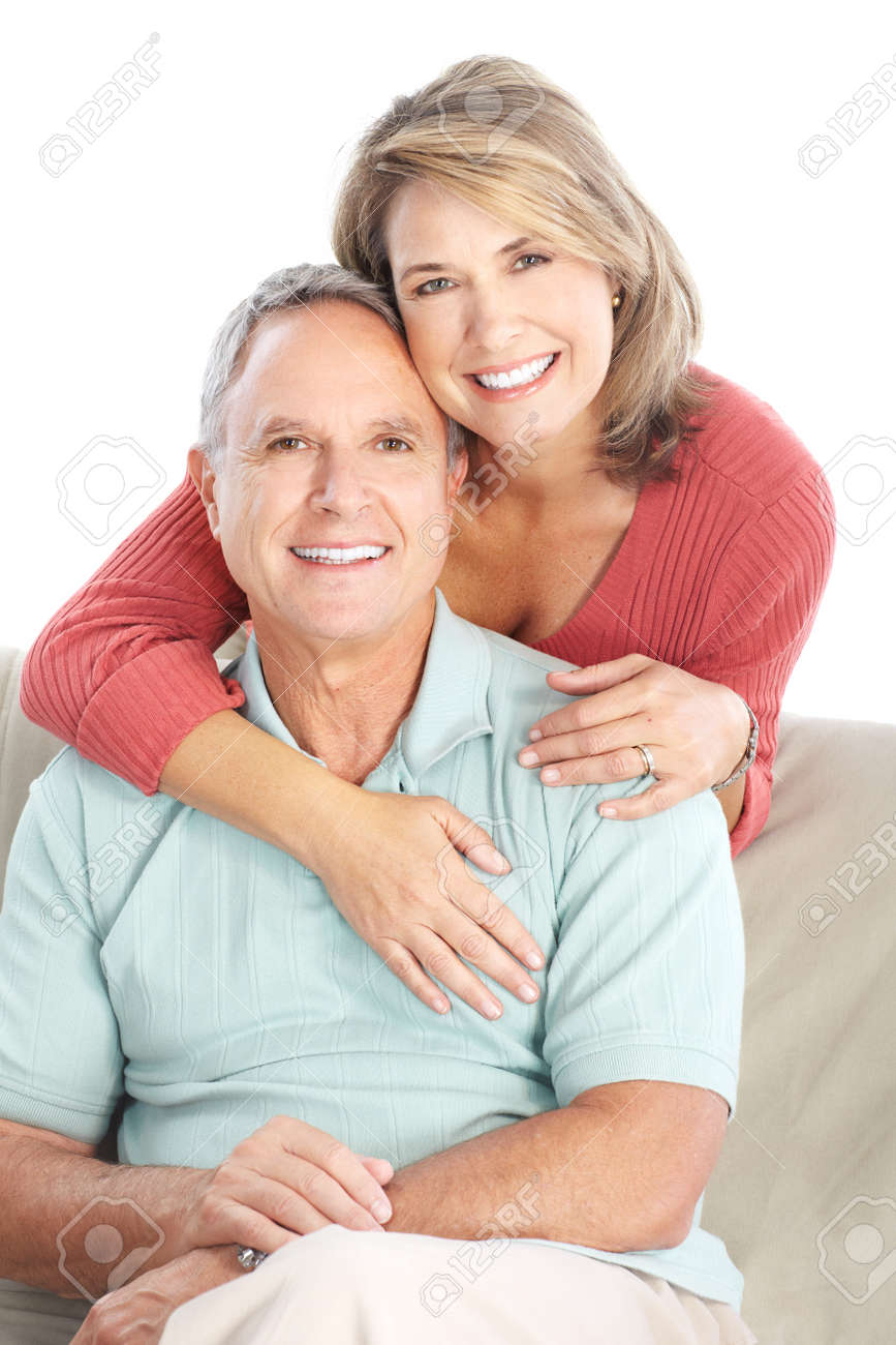 Happy seniors couple in love. Healthy teeth. Isolated over white background Stock Photo - 8863827