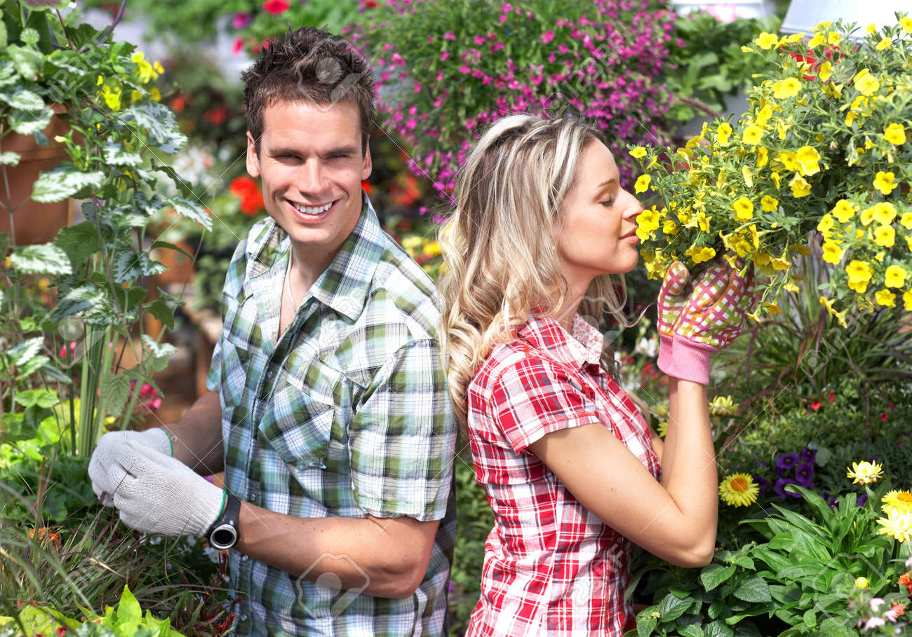 gardening young smiling people florists working in the garden stock photo 8863838