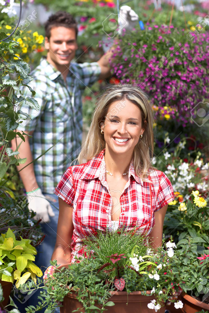 Gardening. Young smiling people florists working in the garden. Stock Photo - 8863794