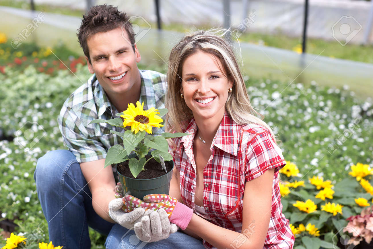gardening young smiling people florists working in the garden stock photo 8863779