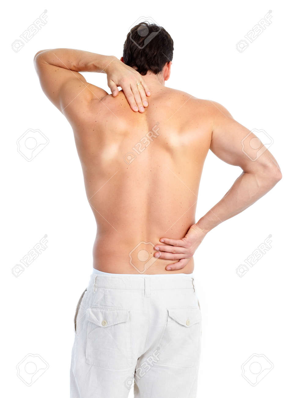Sick young man. Back pain. Over white background Stock Photo - 8868131