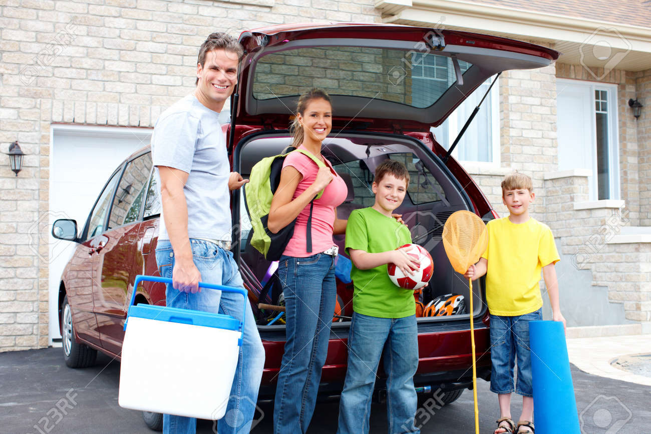 Smiling happy family and a family car Stock Photo - 8950425