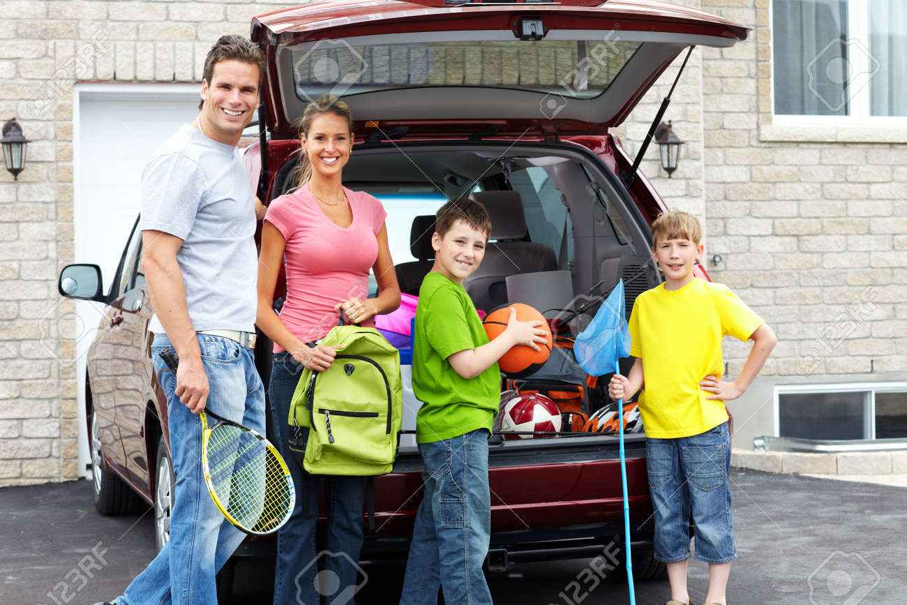 Smiling happy family and a family car Stock Photo - 8950426