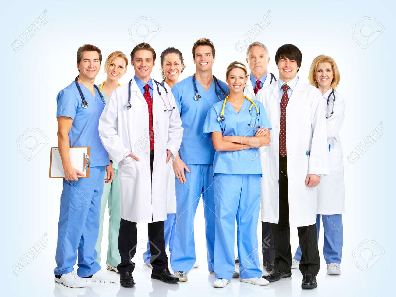 Smiling doctors with stethoscopes. Over blue  background Stock Photo - 8950296