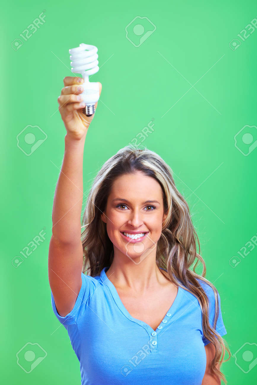 Woman with a fluorescent bulb Stock Photo - 9050255