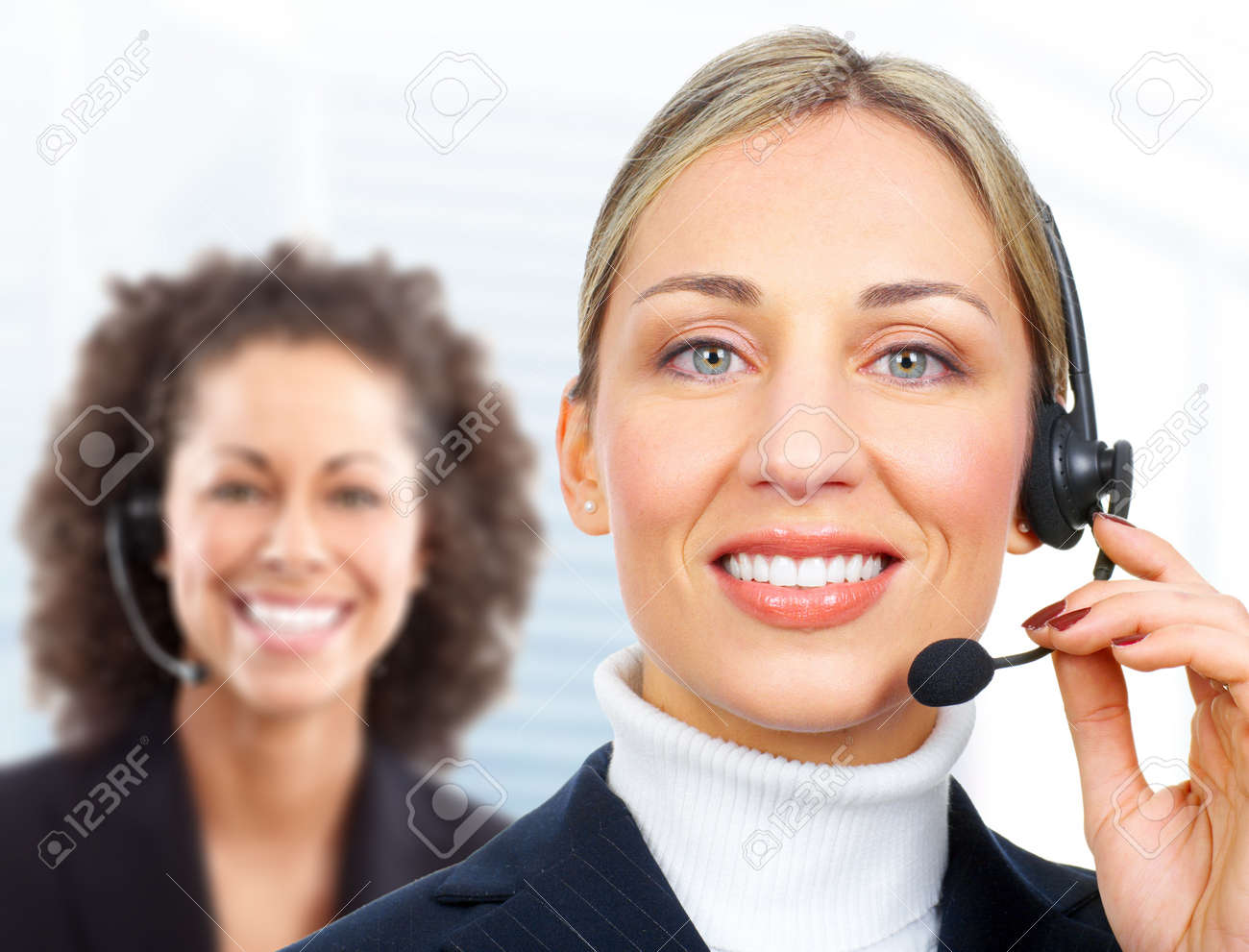 Beautiful  customer service operator woman with headset. Over white background Stock Photo - 9108870