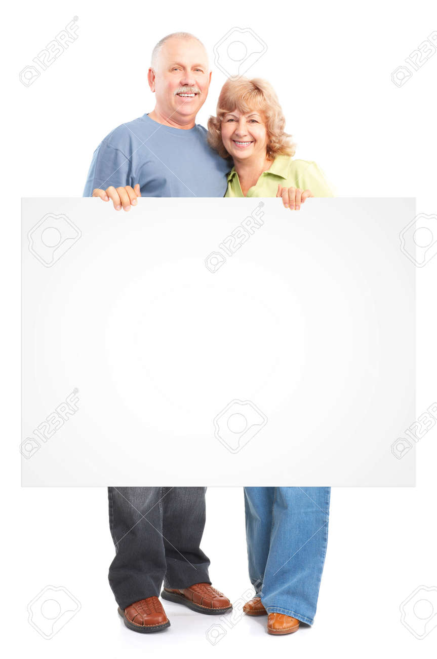 Senior couple with poster. Isolated over white background. Stock Photo - 9138651