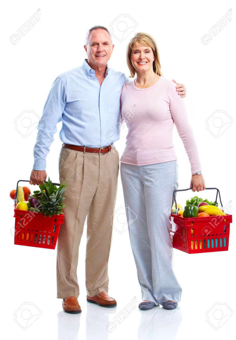 Happy couple with a shopping basket. Stock Photo - 10930330