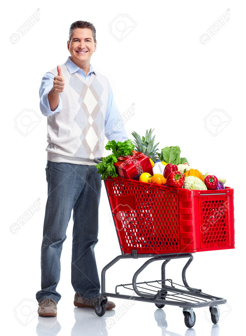 Happy man with a shopping cart. Stock Photo - 10930303