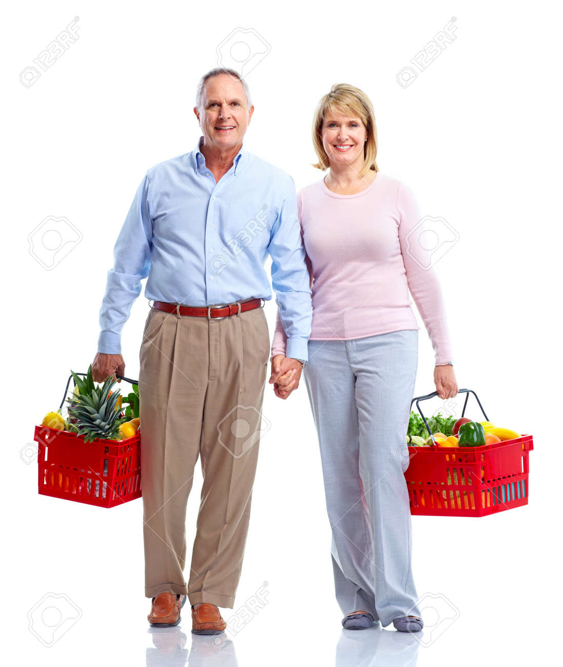 Grocery. Couple with a shopping basket. Stock Photo - 11070656