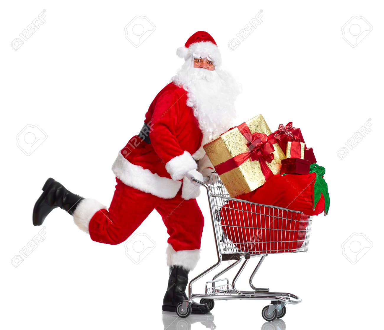 Santa Claus with gifts and shopping trolley. Stock Photo - 11080257
