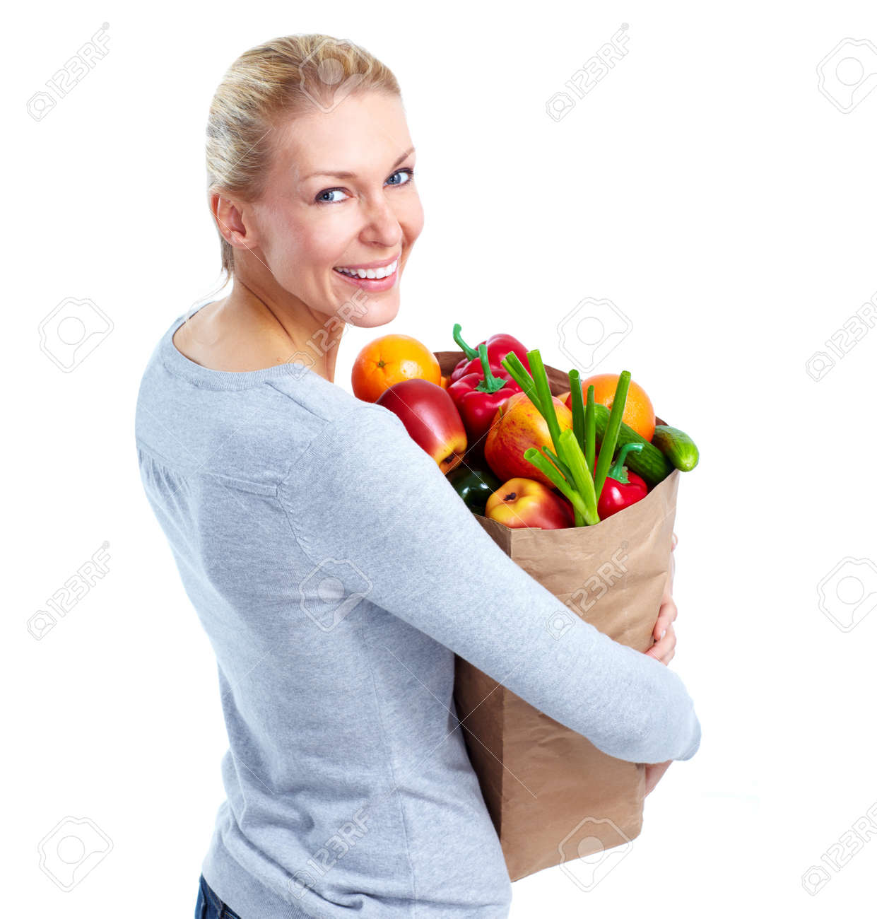 Stock Photo - Young woman with a grocery shopping bag. cc6baa359