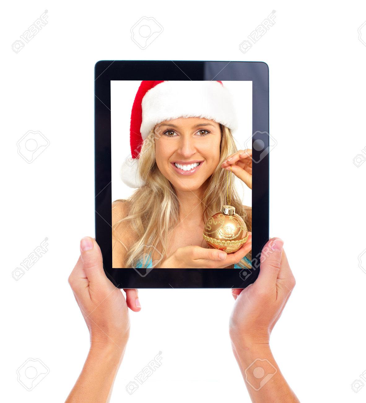 Tablet computer and Christmas girl. Stock Photo - 11478499