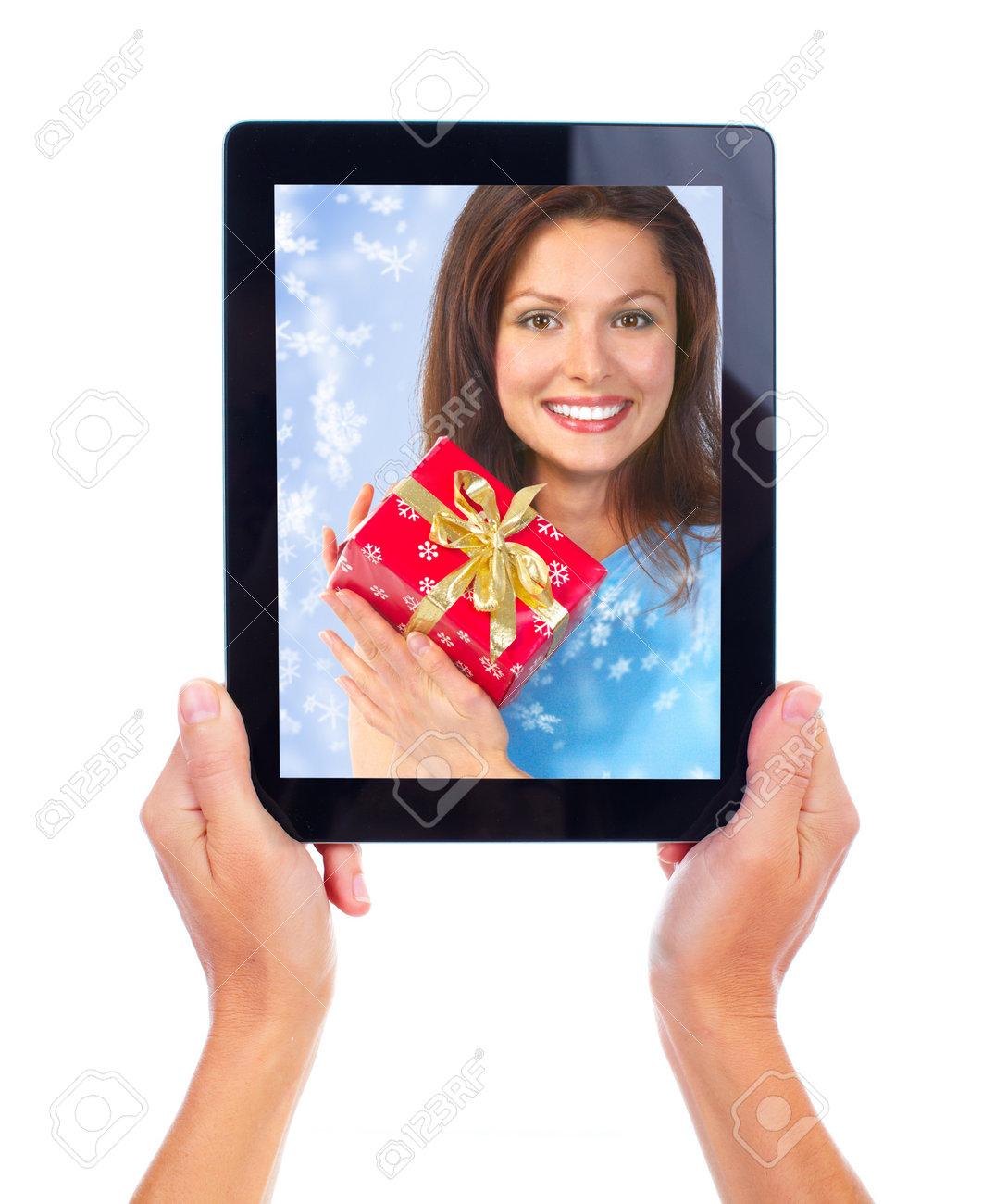 Tablet computer and Christmas girl. Stock Photo - 11478506
