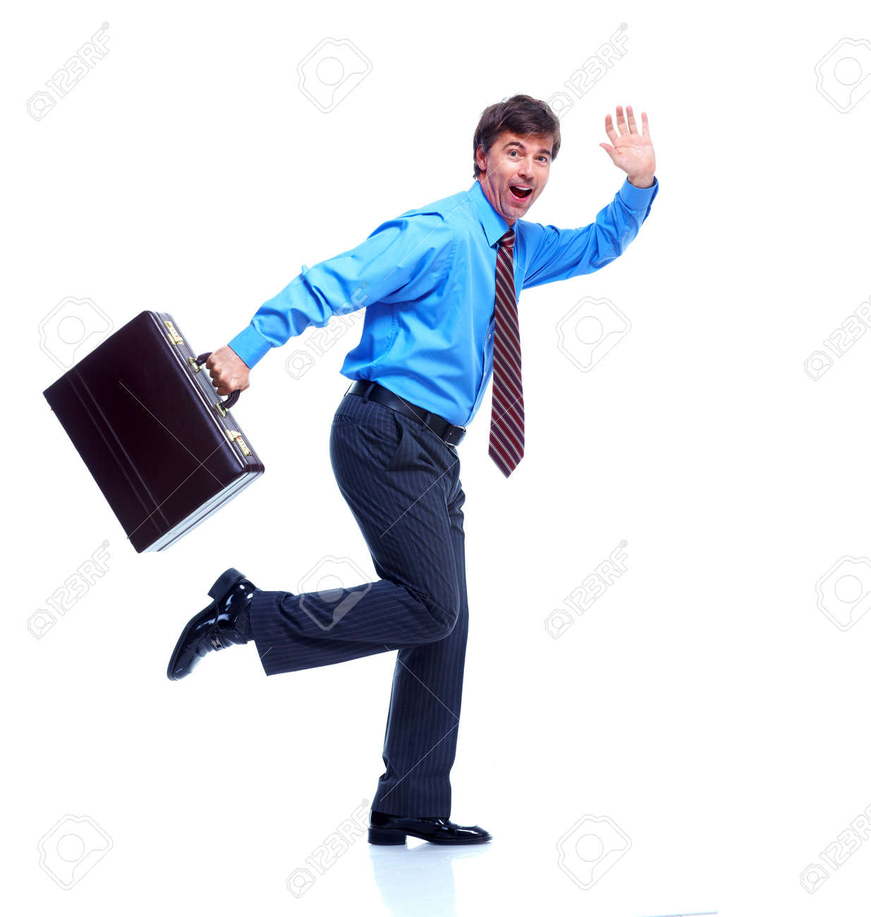 Happy businessman with case. Stock Photo - 12380281